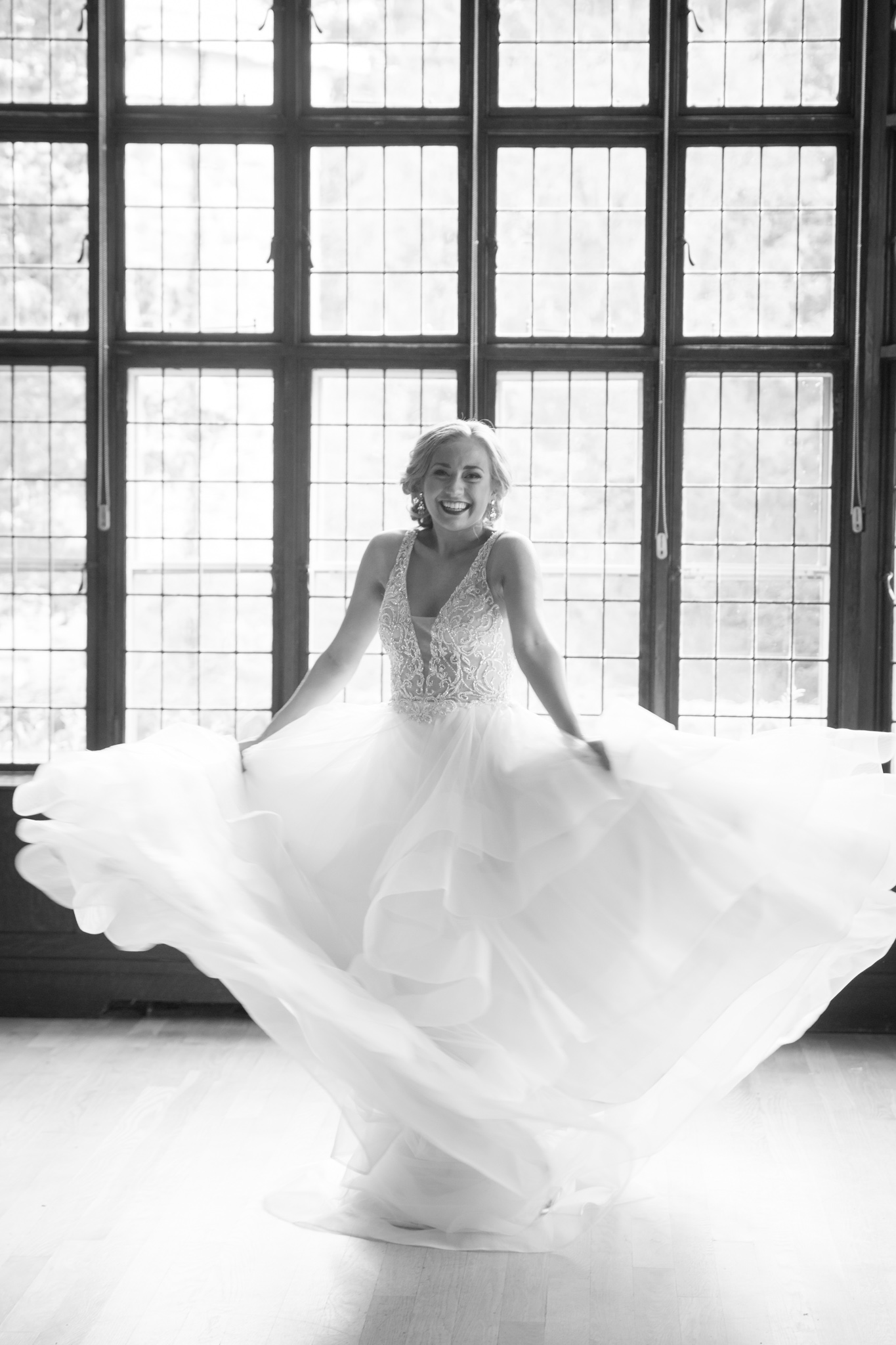Fun loving bride in wedding dress twirling