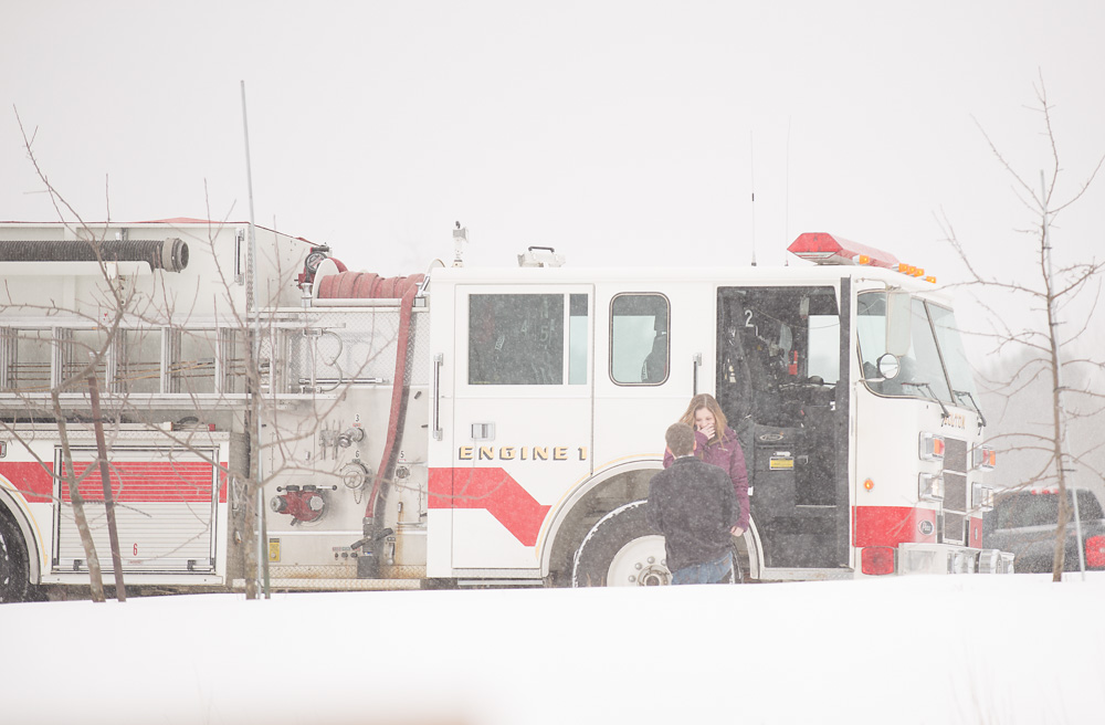 Surprise proposal in the snow with a firetruck in Bolton MA